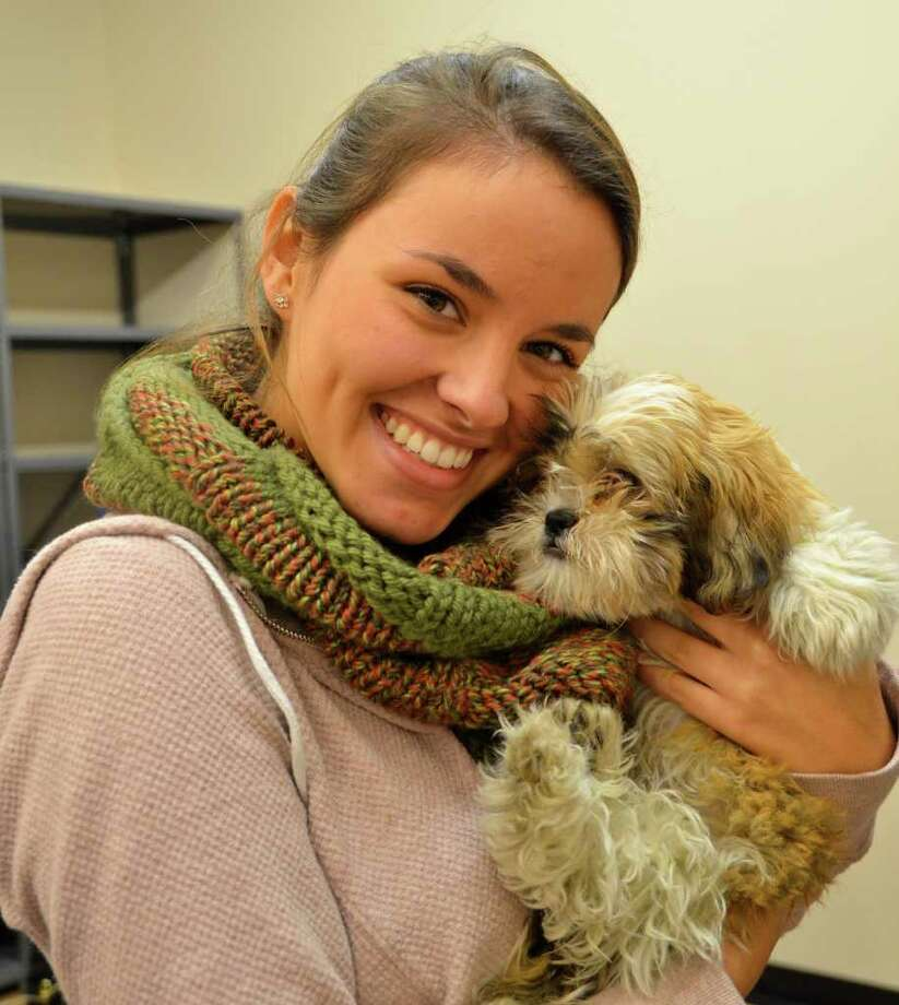 Sixteen-year-old Allie Shulman from Greenwich is smitten with her newly adopted 13-week-old Shih Tzu, during the Adopt-A-Lab event at Darien Global Pet Foods last Saturday, November 19. Photo: Jeanna Petersen Shepard
