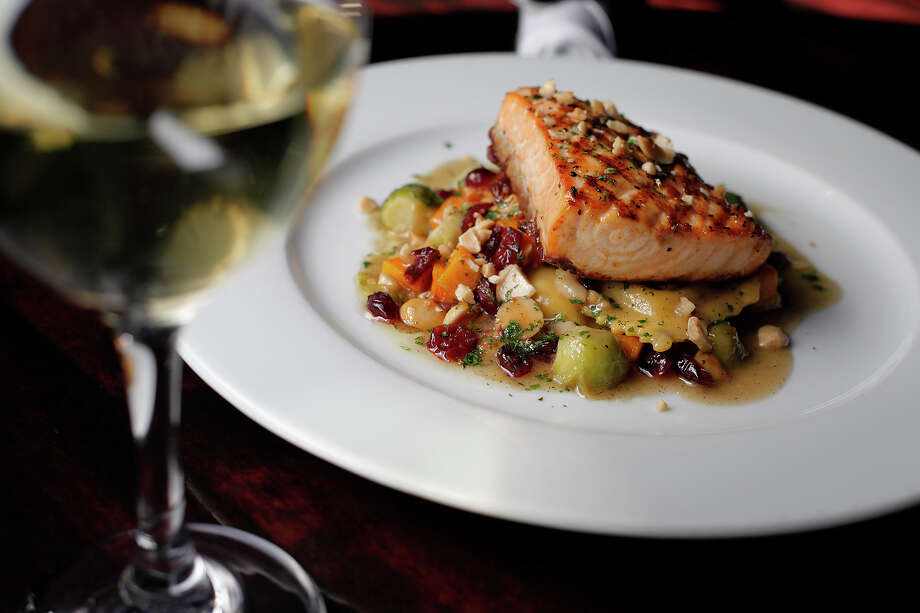 Order the salmon at Paesanos with confidence, but save the spaghetti with sauce for lunch with friends. Express-News file photos Photo: Kin Man Hui, SAN ANTONIO EXPRESS-NEWS / San Antonio Express-News