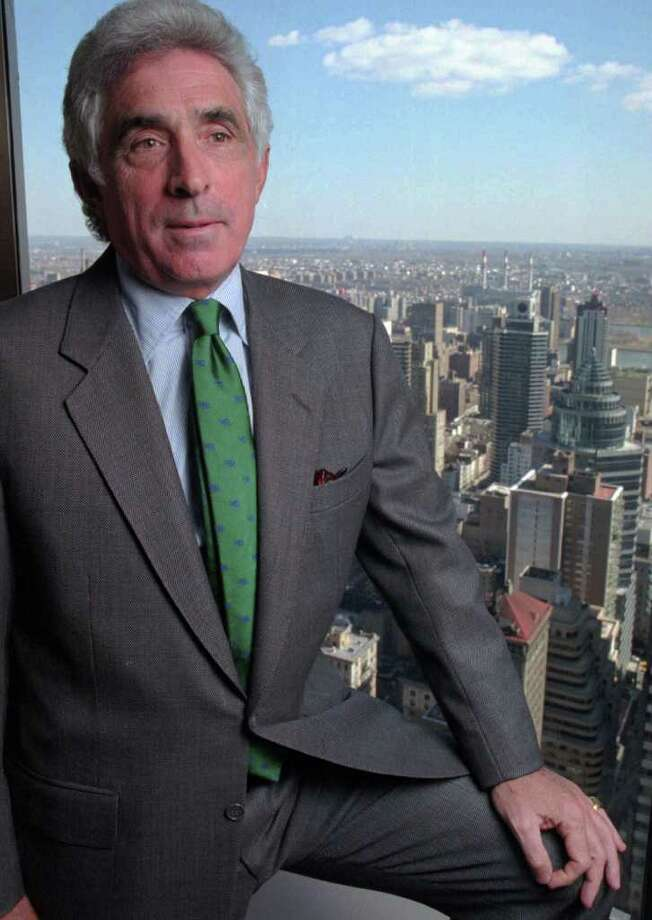 In this 1996 photo, takeover artist Ted Forstmann poses in his office in New York. Forstmann, a longtime financier, died Sunday, Nov. 20, 2011, at the age of 71. (AP Photo/Mark Lennihan) Photo: Mark Lennihan, Associated Press / AP1996