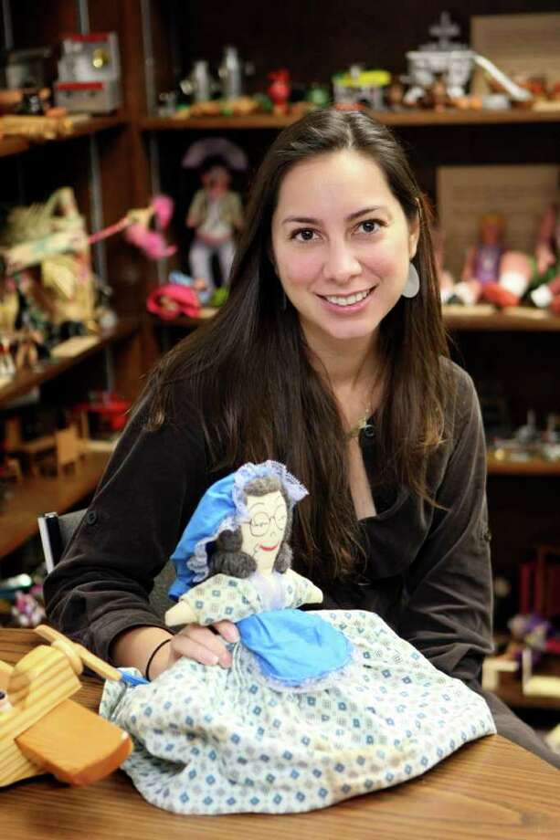 SA LIFE: The Institute of Texan Cultures will open the Timeless Texas Toys exhibit on Nov. 19.  Dr. Sarah Gould is the curator for the exhibit.  HELEN L. MONTOYA/hmontoya@express-news.net Photo: HELEN L. MONTOYA, HMONTOYA@EXPRESS-NEWS.NET / SAN ANTONIO EXPRESS-NEWS