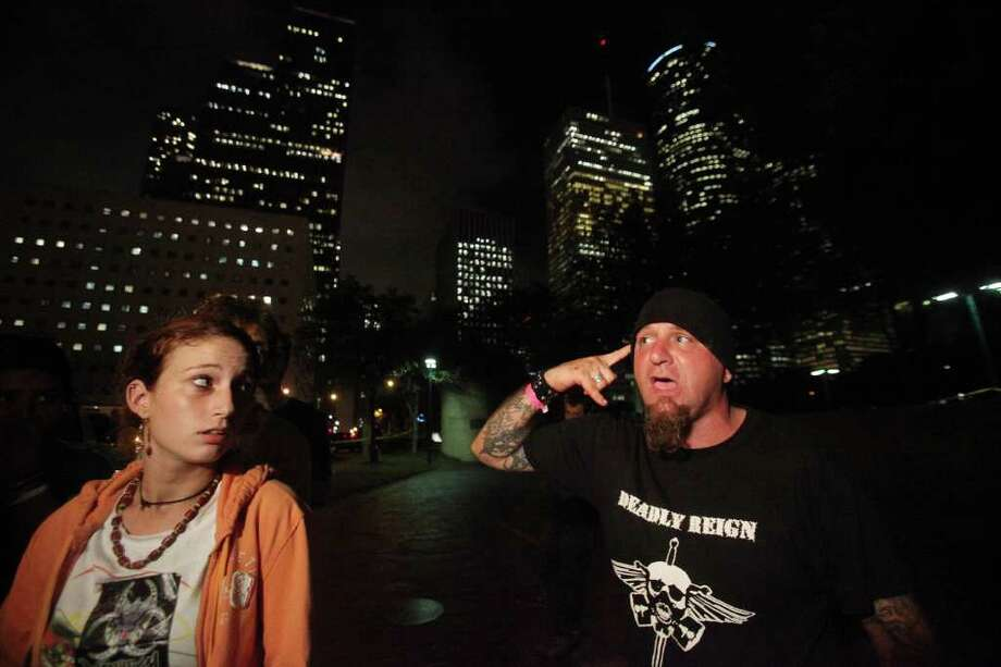 "Amy Tepper and ""J.J."" talk about their experience when a gunman walked into Occupy Houston camp at Tranquillity Park and shot into the air Monday.  Tepper says she was terrified when the gunman pointed the gun at her. Photo: Mayra Beltran, Houston Chronicle / © 2011 Houston Chronicle"