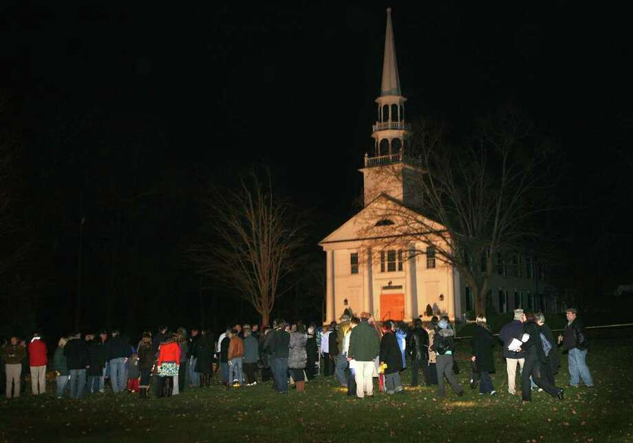 Congregants gather for a prayer service on the lawn in front of the Saugatuck Congregational Church at 245 Post Road East in Westport on Monday evening, November 21, 2011. The church was severely damaged by a fire on Sunday night. Photo: Brian A. Pounds / Connecticut Post