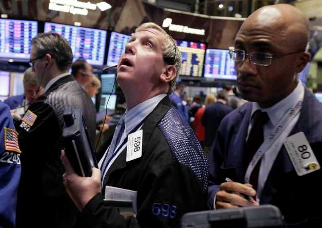 Traders Richard Cohen, left, and Lewis Vande-Pallen, right, work on the floor of the New York Stock Exchange Monday, Nov. 21, 2011. Stocks are taking a sharp fall in early trading Monday amid reports that a congressional committee will fail to agree on a plan to cut the U.S. government's budget deficit.(AP Photo/Richard Drew) Photo: Richard Drew
