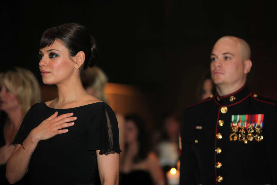 Mila KunisMarine DreamSgt. Scott Moore took to YouTube to attempt something few non-Hollywood types have been successful at: to ask out Kunis. And guess what? It worked. The starlet made good on her word and accompanied the marine to his military ball in Greenville, North Carolina. Photo: CPL JOHNNY MERKLEY, Getty / AFP