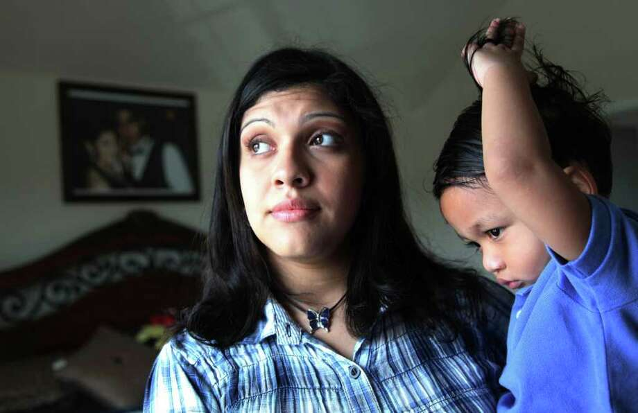 "MAYRA BELTRAN : CHRONICLE   WHERE'S DADDY?: Rose Marie Ascencio-Escobar says of her son, Walter Escobar, 2, and his daddy, Jose Escobar, ""It felt like having two kids. They're goofy together."" Photo: Mayra Beltran / © 2011 Houston Chronicle"