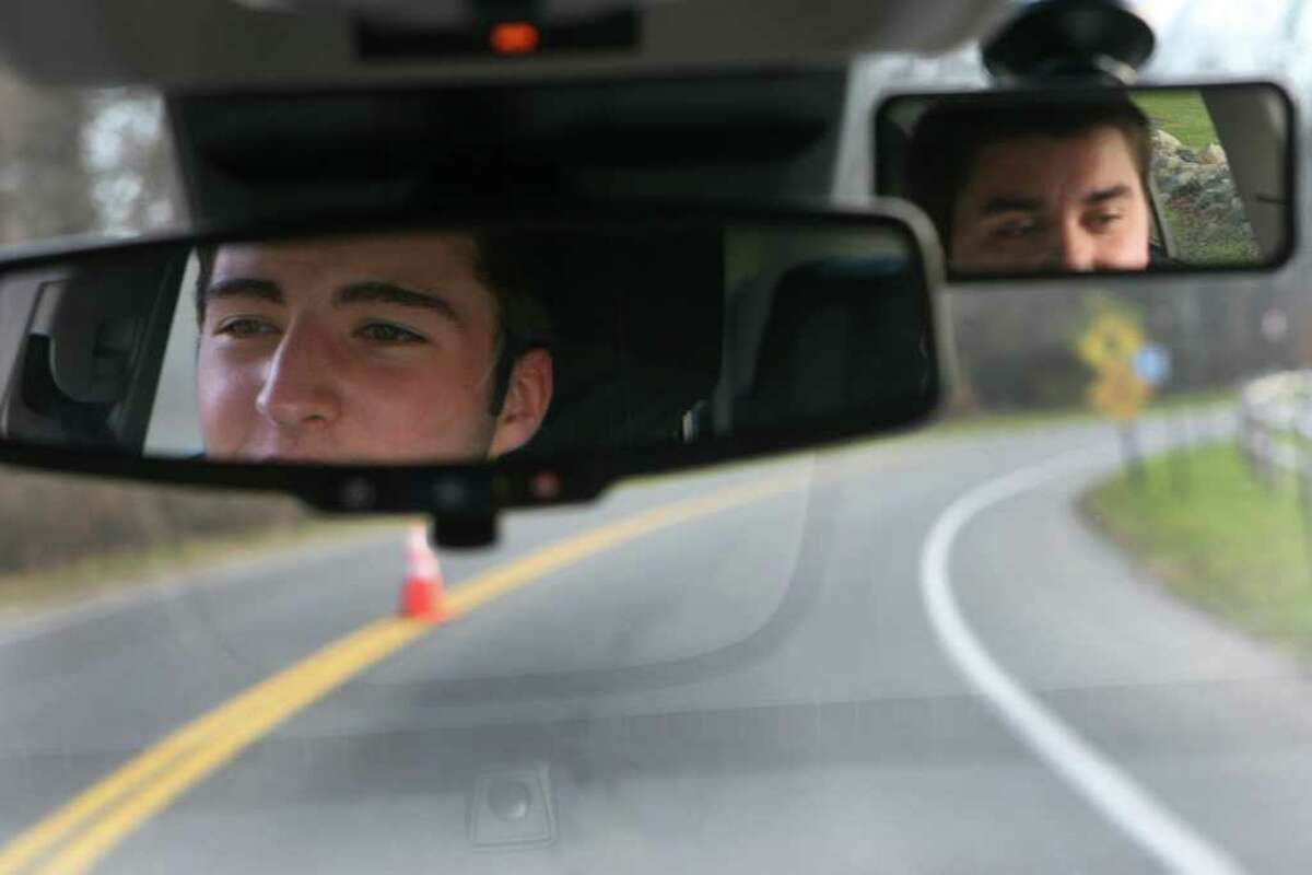 Weston HIgh School student Max Catucci, 16, left, takes a driving lesson with Matt Debernardis, of All-Star Driver, on Monday, November 21, 2011.