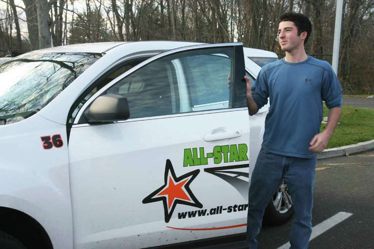 Weston HIgh School student Max Catucci, 16, takes a driving lesson with All-Star Driver, on Monday, November 21, 2011.