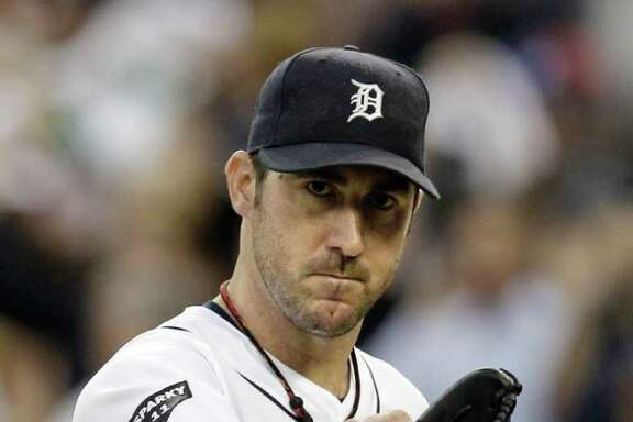 FILE - In this Oct. 13, 2011, file photo, Detroit Tigers starting pitcher Justin Verlander reacts after the final out in the sixth inning in Game 5 of baseball's American League championship series against the Texas Rangers in Detroit. Verlander won the American League MVP  Award in voting announced Monday, Nov. 21, 2011. (AP Photo/Paul Sancya, File)