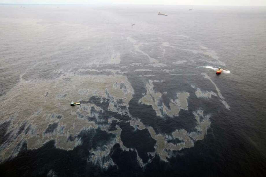 This photo taken Nov. 18, 2011 and released by Rio de Janeiro's government, shows an aerial view of vessels in the clean up of an oil spill in an offshore field operated by Chevron at the Bacia de Campos, in Rio de Janeiro state, Brazil. Rio de Janeiro state's environment secretary, Carlos Minc, says Brazil is expected to fine Chevron nearly $28 million for the ongoing offshore oil spill and will also ask Chevron to pay for damages caused by the Atlantic spill. Minc said Monday he considers the fine way too lenient, but it's the maximum allowed under current Brazilian law. (AP Photo/Rio de Janeiro's government,Rogerio Santana) Photo: Rogerio Santana / Rio de Janeiro's Government