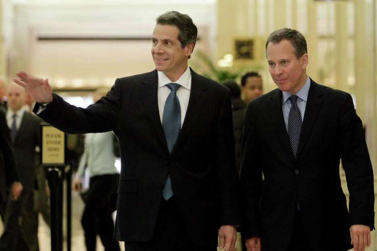 New York state Attorney General and Gov.-elect Andrew Cuomo, left, and his successor, New York state Sen. Eric Schneiderman, walk to a news conference, Friday, Nov. 12, 2010, in New York. (AP Photo/Richard Drew)
