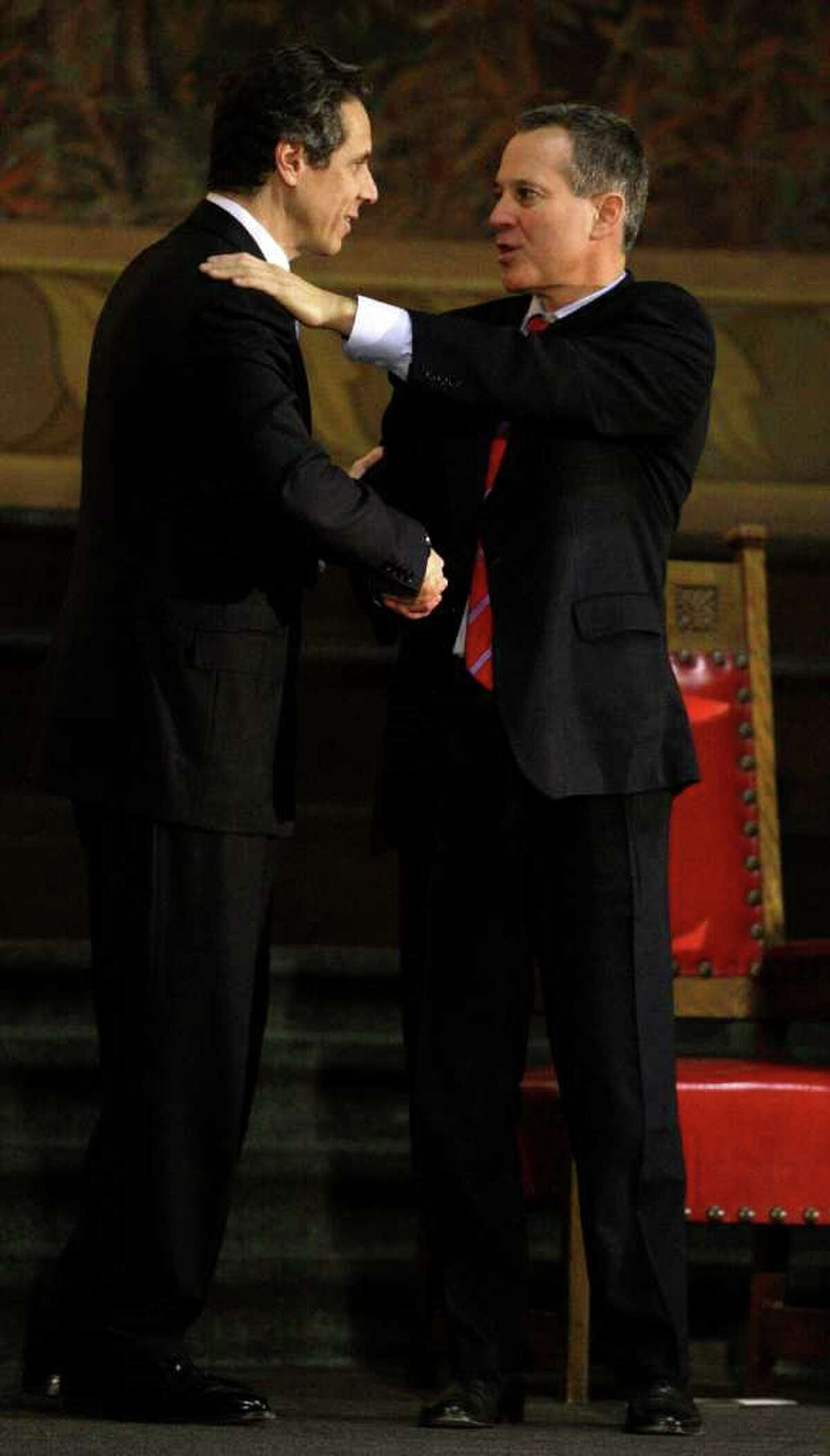 New York State Attorney General Eric Schneiderman, right, shakes hands with Gov. Andrew Cuomo at a swearing-in ceremony at City College Thursday, Jan. 6, 2011 in New York. (AP Photo/Frank Franklin II)