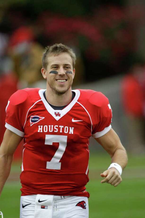 Houston quarterback Case Keenum (7) is introduced before an NCAA college football game against SMU Saturday, Nov. 19, 2011, in Houston. (AP Photo/David J. Phillip) Photo: David J. Phillip / AP