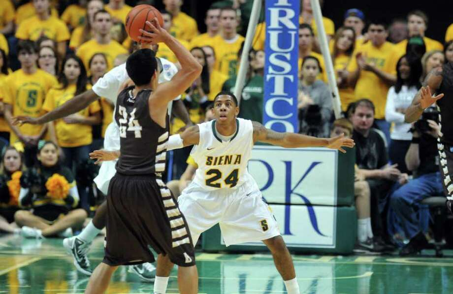 Siena's Davonte Beard, right, defends St. Bonaventure's Matthew Wright during the first half of Siena's 64-58 loss at the Times Union Center on Monday night Nov. 21, 2011 in Albany, NY. (Philip Kamrass / Times Union ) Photo: Philip Kamrass / 00015373B