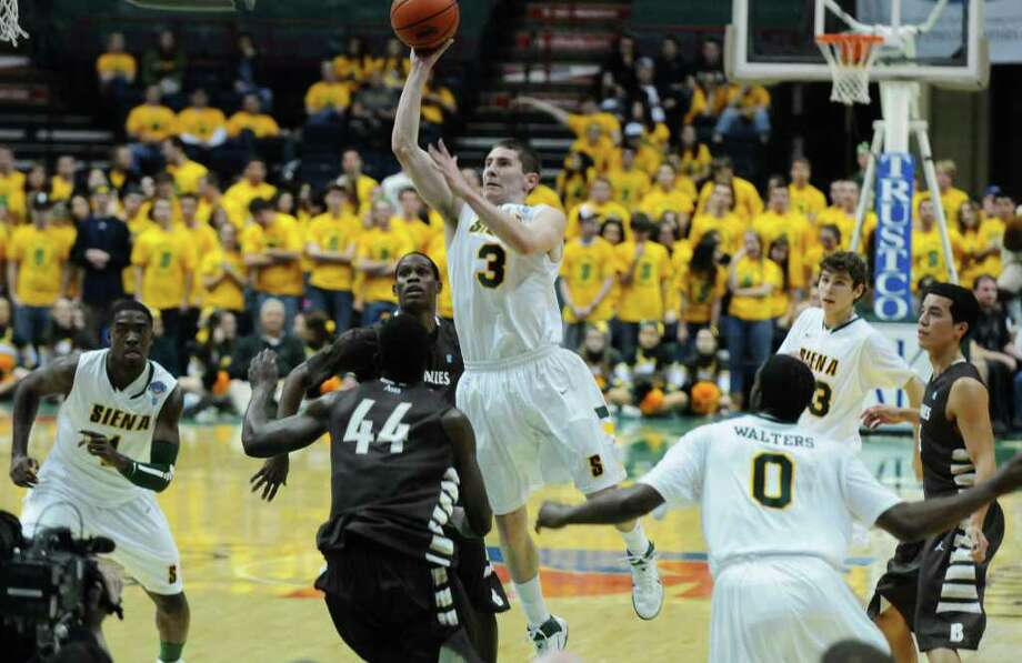 Siena's Kyle Downey puts up a shot during Siena's 64-58 loss to St. Bonaventure at the Times Union Center on Monday night Nov. 21, 2011 in Albany, NY. (Philip Kamrass / Times Union ) Photo: Philip Kamrass / 00015373B
