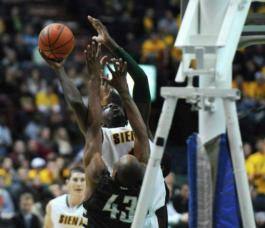 Siena's OD Anosike puts up a shot during Siena's 64-58 loss to St. Bonaventure at the Times Union Center on Monday night Nov. 21, 2011 in Albany, NY. (Philip Kamrass / Times Union ) Photo: Philip Kamrass / 00015373B