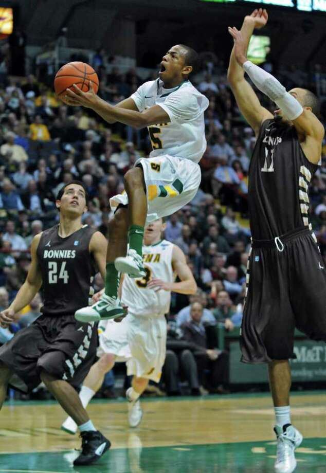 Siena's Evan Hymes drives to the basket during the second half of Siena's 64-58 loss to St. Bonaventure at the Times Union Center on Monday night Nov. 21, 2011 in Albany, NY. (Philip Kamrass / Times Union ) Photo: Philip Kamrass / 00015373B