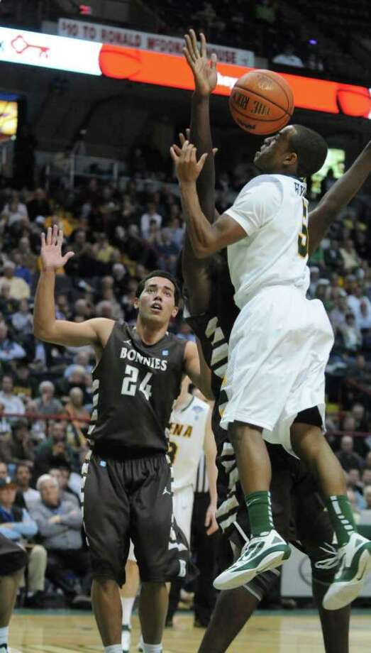 Siena's Evan Hymes loses the ball while driving to the basket during the second half of Siena's 64-58 loss to St. Bonaventure at the Times Union Center on Monday night Nov. 21, 2011 in Albany, NY. (Philip Kamrass / Times Union ) Photo: Philip Kamrass / 00015373B
