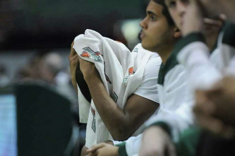 Siena's Evan Hymes sits on the bench with a towel on his head after fouling out during the second half of Siena's 64-58 loss to St. Bonaventure at the Times Union Center on Monday night Nov. 21, 2011 in Albany, NY. (Philip Kamrass / Times Union ) Photo: Philip Kamrass / 00015373B