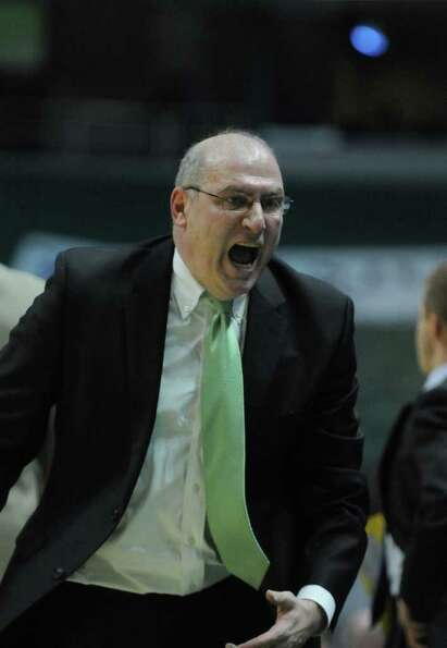Siena men's basketball coach Mitch Buonaguro reacts angrily during the second half of Siena's 64-58