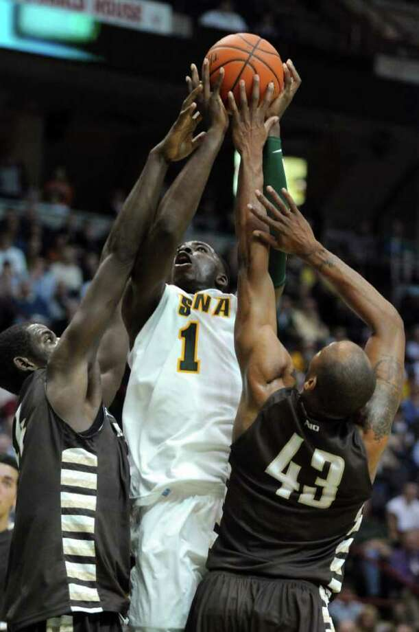 Siena OD Anosike battles to put up a shot during the second half of Siena's 64-58 loss to St. Bonaventure at the Times Union Center on Monday night Nov. 21, 2011 in Albany, NY. (Philip Kamrass / Times Union ) Photo: Philip Kamrass / 00015373B