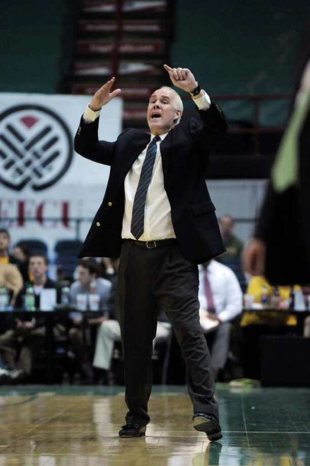 St. Bonaventure men's basketball coach Mark Schmidt leads his team during the second half of their victory over Siena at the Times Union Center on Monday night Nov. 21, 2011 in Albany, NY. (Philip Kamrass / Times Union ) Photo: Philip Kamrass / 00015373B