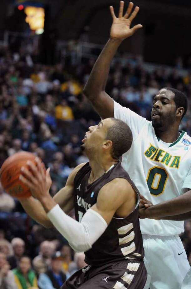 Siena's Brandon Walters, right, defends St.  Bonaventure's Demitrius Conger, left, during Siena's 64-58 loss at the Times Union Center on Monday night Nov. 21, 2011 in Albany, NY. (Philip Kamrass / Times Union ) Photo: Philip Kamrass / 00015373B