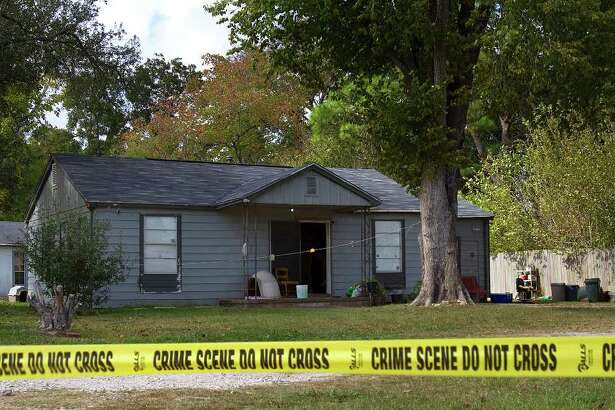 A house where the shooting, of a teenager and her father, took place is seen Monday, Nov. 21, 2011, in Texas City. The two were allegedly killed by by a pair of ski mask-wearing robbers in their home around 2 a.m. Monday morning. (Cody Duty / Houston Chronicle)