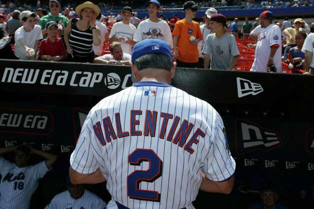 Manager Bobby Valentine of the New York mets signs autographs during the game against the Atlanta Braves at Shea Stadium in Flushing, New York on April 17, 2002.  Photo: Getty Images / 2010 Getty Images