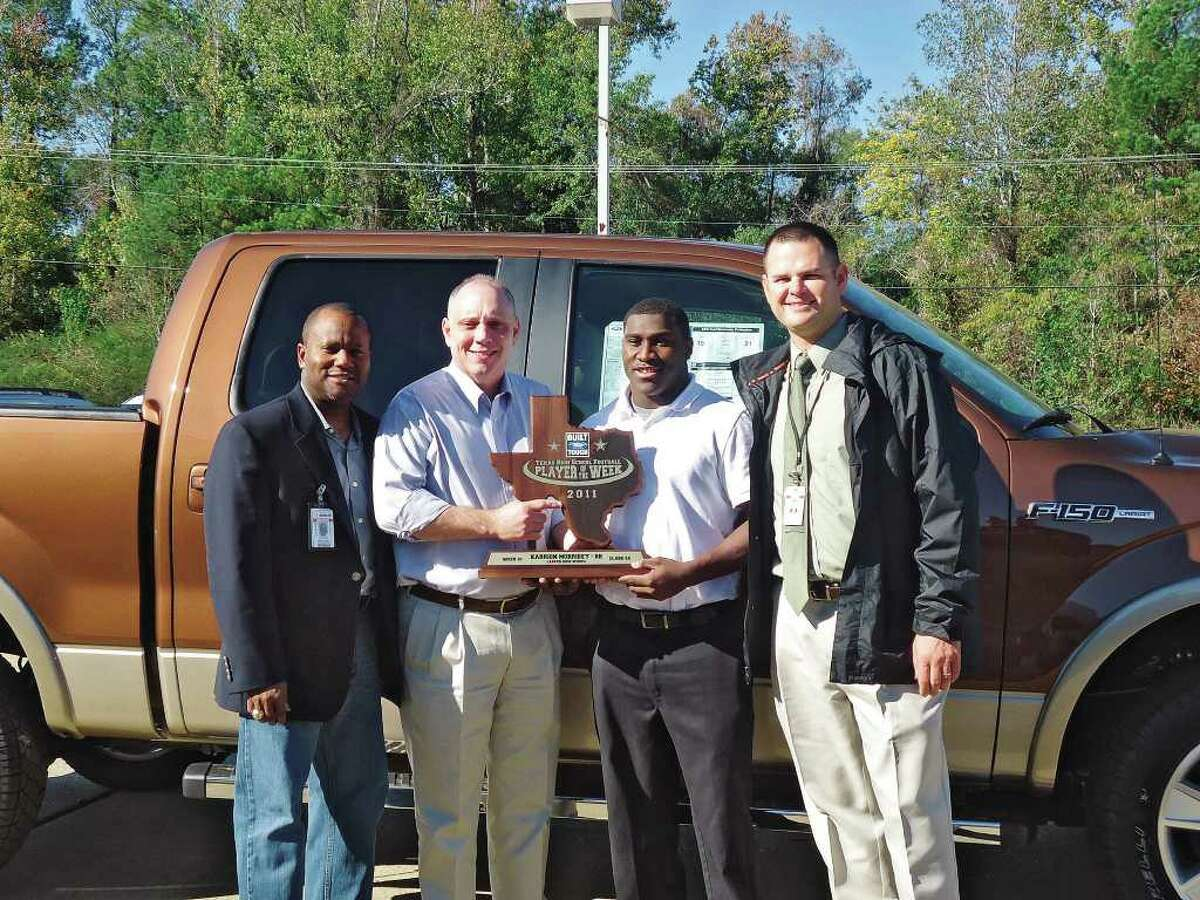 Jasper's Karrion Morrisey accepts his Built Ford Tough Player of the Week award at Jasper Ford.