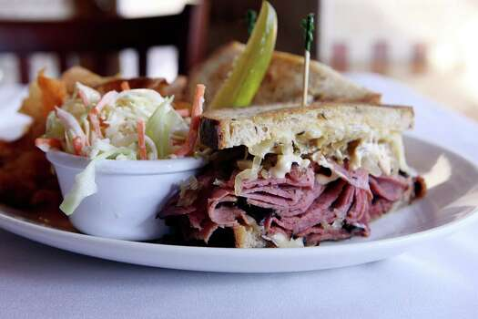Reuben sandwich from Drew's American Grill is the right mix of flavors and textures that makes this such a memorable sandwich. www.drewsamericangrill.com Photo: HELEN L. MONTOYA, SAN ANTONIO EXPRESS-NEWS / hmontoya@express-news.net