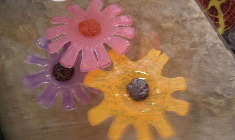 715 S. Alamo St: Glass flower bowls are made at Garcia Art Glass. Photo: Jennifer Rodriguez, FOR THE EXPRESS-NEWS