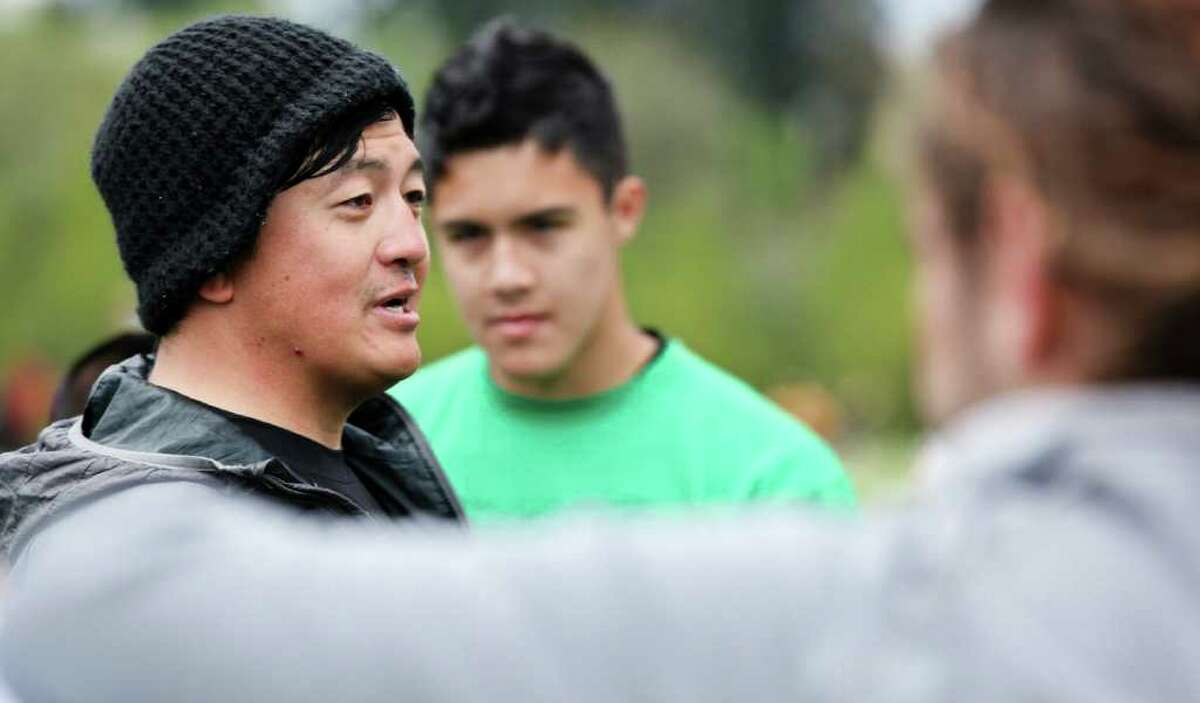 Frank Nam, a coach for the Franklin High School boys ultimate team, talks with his team before a game at the USA Ultimate High School Westerns Championships in Corvallis, Ore., in May.