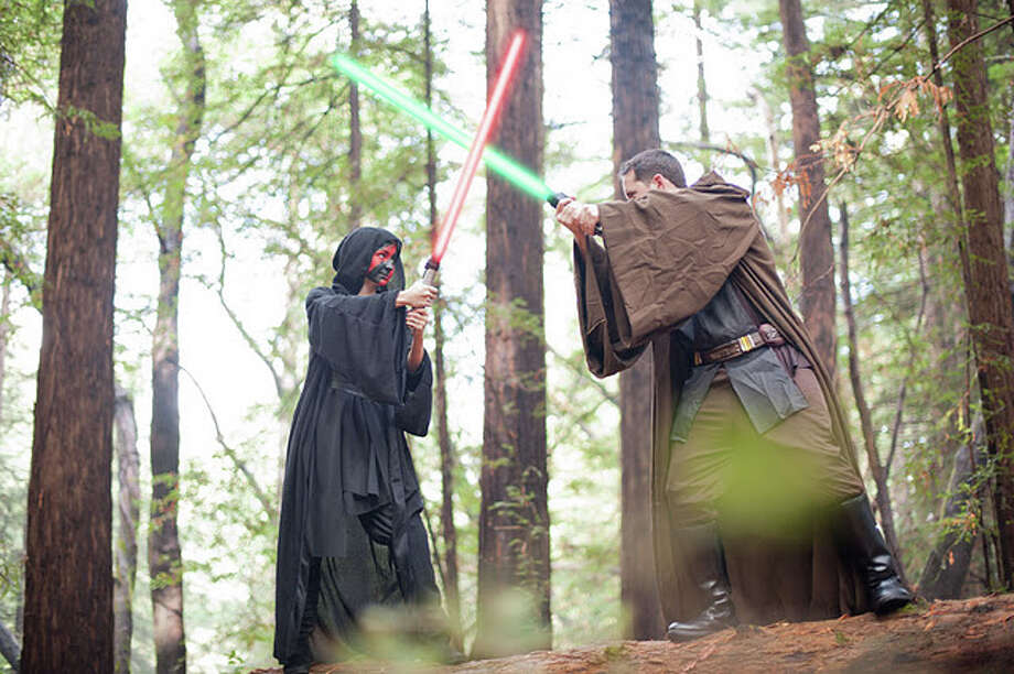 Are these the greatest, geekiest engagement photos ever? One Bay Area couple eschewed the classic poses and generic outfits of a typical photo shoot, opting for lightsabers instead. The resulting photos, shot by Michael James of Michael James Photography, do an incredible job of capturing the couple's creative spirit.  Here are some of our favorite shots, but you can see them all on the Michael James Photography website. Photo: Michael James/Michael James Photography
