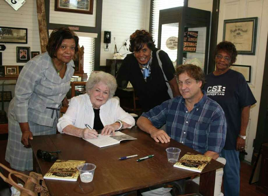 "COURTESY REBECCA COLLINS HISTORY LESSON: La Porte Bay Area Heritage Society members Ann Malone and Dan Becker (seated) coauthored ""Around La Porte,"" published by Arcadia Publishing. Pictured with the authors  are, from left, Rachel Carter, Lola Phillips and Mary Gay. Photo: COURTESY REBECCA COLLINS"