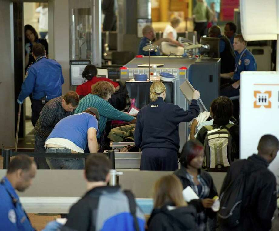 Are those First-Time Fliers holding up the security line? Photo: JIM WATSON, AFP/Getty Images / 2010 AFP