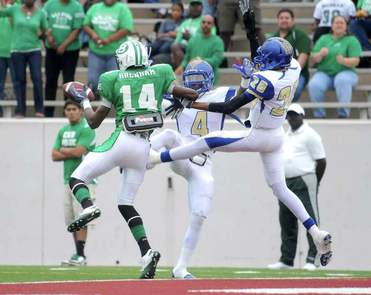 Ozen's Tony Brown (4) and Raleigh Johnson (20) break up a touch down pass intended for Brenham's Kwadareus Chapel at Thorne Stadium in Aldine, Saturday, November 19, 2011. Tammy McKinley/The Enterprise