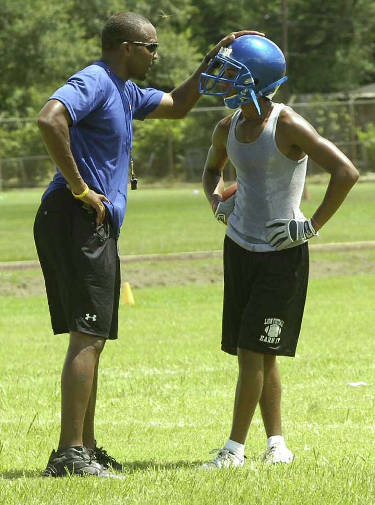 Ozen coach Tony Brown, left, tells one of his players