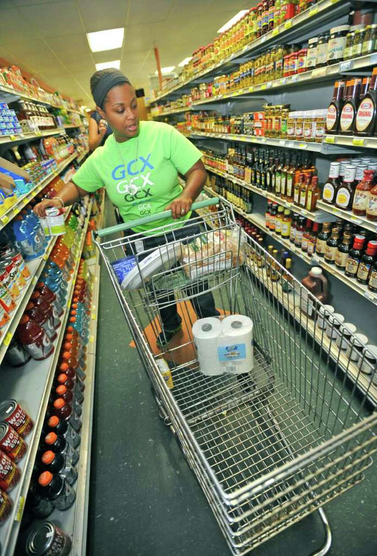 Jevonne Pollard, owner of Grocery Cart Xpress, heads down an aisle at Jack's Pak-It Monday morning. Grocery Cart Xpress, is a fairly new service in Southeast Texas that does your grocery and pet store shopping for you. The Shopper undergoes training specific to quality control in fresh produce and foods. Dave Ryan/The Enterprise