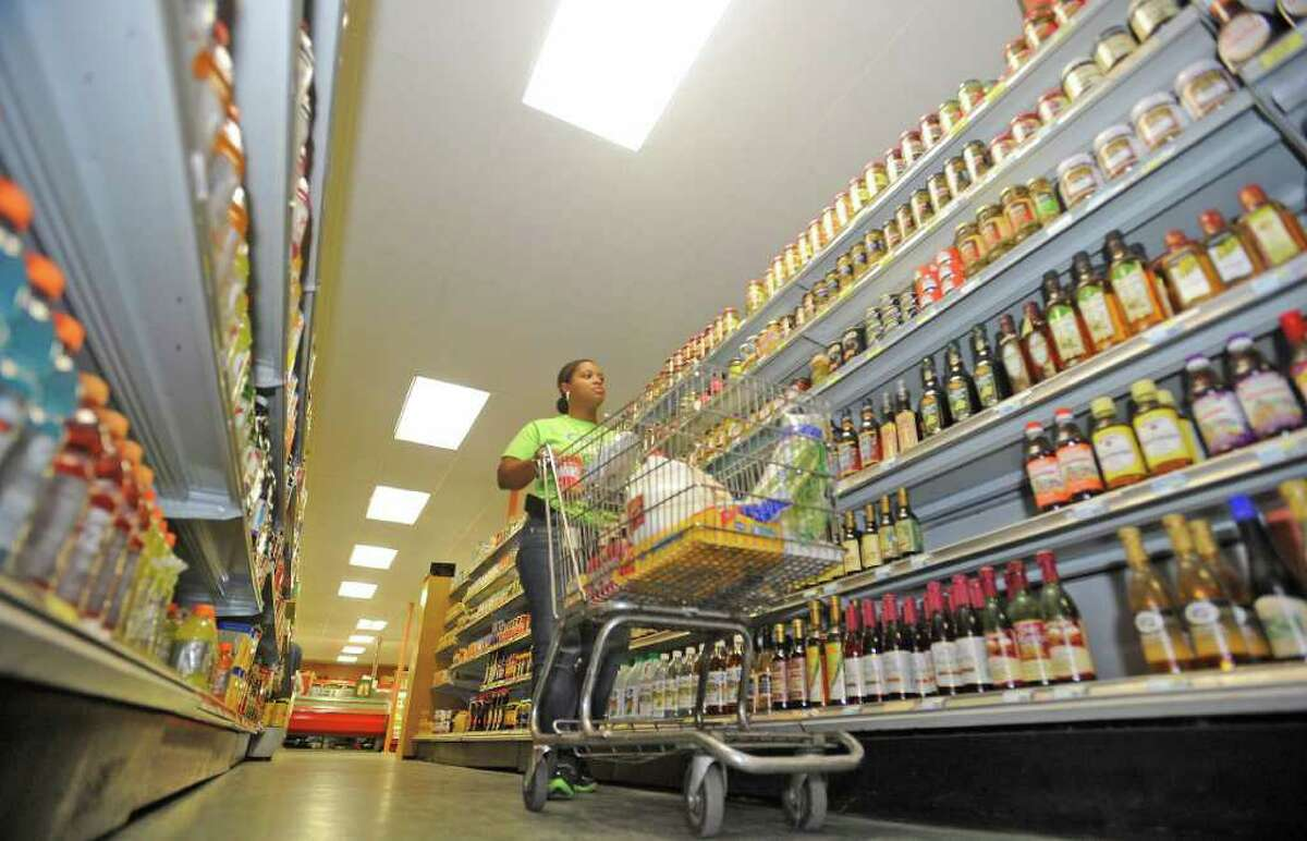 Jevonne Pollard, owner of Grocery Cart Xpress, heads down an aisle at Jack's Pak-It Monday morning. Grocery Cart Xpress is a fairly new service in Southeast Texas that does your grocery and pet store shopping for you. The Shopper undergoes training specific to quality control in fresh produce and foods. Dave Ryan/The Enterprise