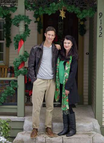 "Tom Cavanagh and Gabrielle Miller star in ""Debbie Macomber's Trading Christmas,"" part of Hallmark Channel's 1,300 hours of holiday-themed programming. Photo: Chris Helcermanas-Benge, Hallmark Channel / ©2011 Crown Media United States"
