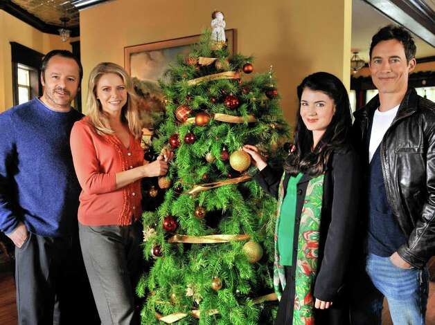 "The ""Trading Christmas"" cast includes Gil Bellows (from left), Faith Ford, Gabrielle Miller and Tom Cavanagh. Photo: Chris Helcermanas-Benge, Hallmark Channel"