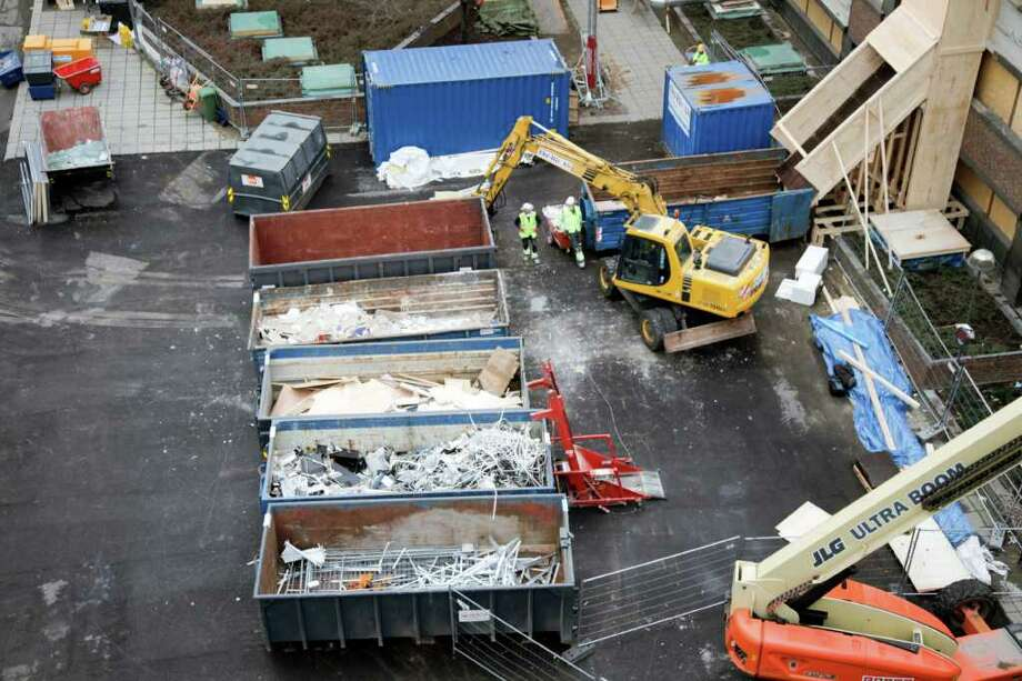 Workers in the city centre  of Oslo, Norway, on Tuesday Nov. 22 2011 continue the cleanup of the area where the bomb planted by Anders Behring Breivik went off on the 22nd of July. Picture shows environmental sorting of building waste material. (AP Photo/Statsbygg / Scanpix Norway) / Statsbygg Construction