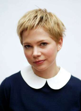 """In this Oct. 23, 2011 photo, actress Michelle Williams poses for a portrait in Los Angeles. Williams stars as Marilyn Monroe in the film """"My Week with Marilyn"""" which will be released in theaters Nov. 23. (AP Photo/Matt Sayles) Photo: Matt Sayles, STF / AP"""