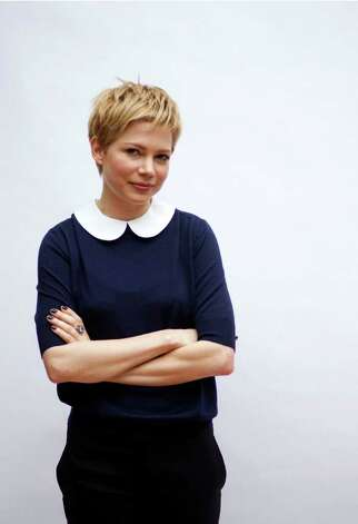 """In this Oct. 23, 2011 photo, actress Michelle Williams poses for a portrait in Los Angeles. Williams stars as Marilyn Monroe in the film """"My Week with Marilyn"""" which will be released in theaters Nov. 23. (AP Photo/Matt Sayles) Photo: Matt Sayles, STF / AP2011"""