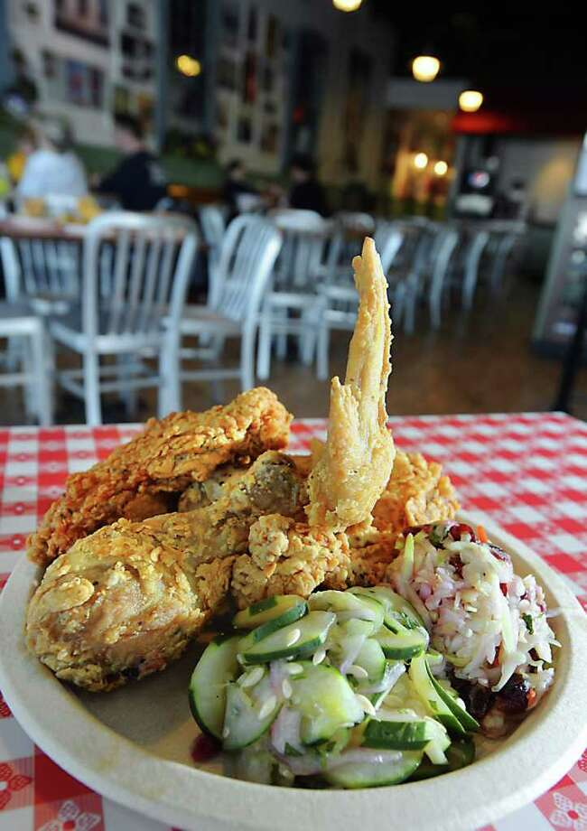Hattie's Famous Fried Chicken with Cucumber Salad and Cranberry Cole Slaw at Hattie's Express in Wilton, NY on January 17, 2011. (Lori Van Buren / Times Union) Photo: Lori Van Buren / 10011755A