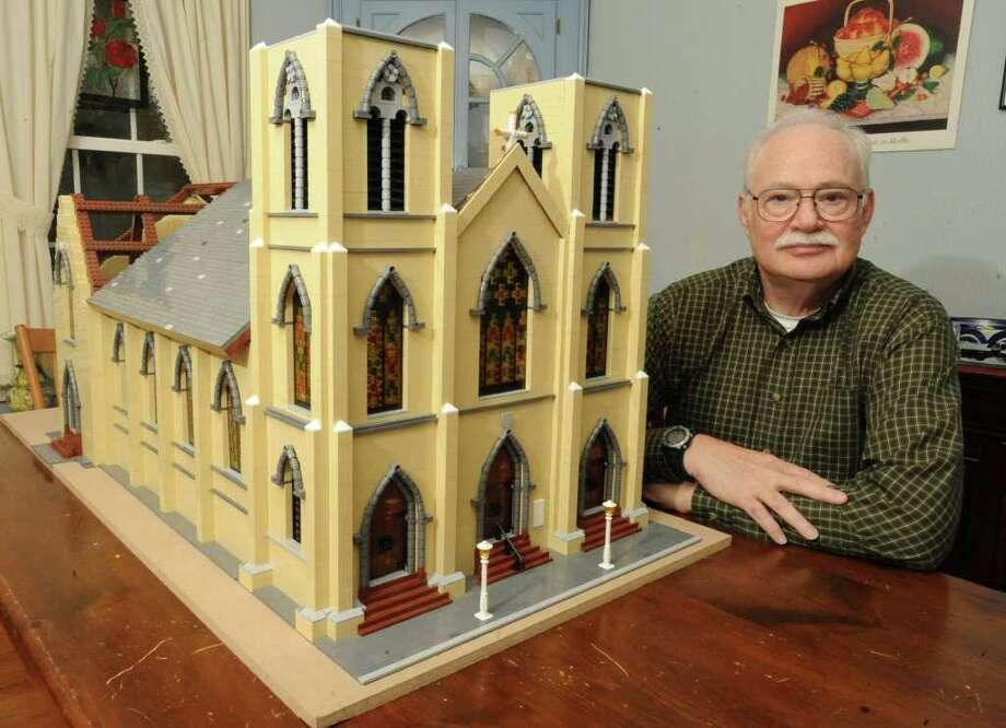 Bill Leue sits next to his lego model of Trinity Church in his home in Albany.  (Lori Van Buren / Times Union) Photo: Lori Van Buren