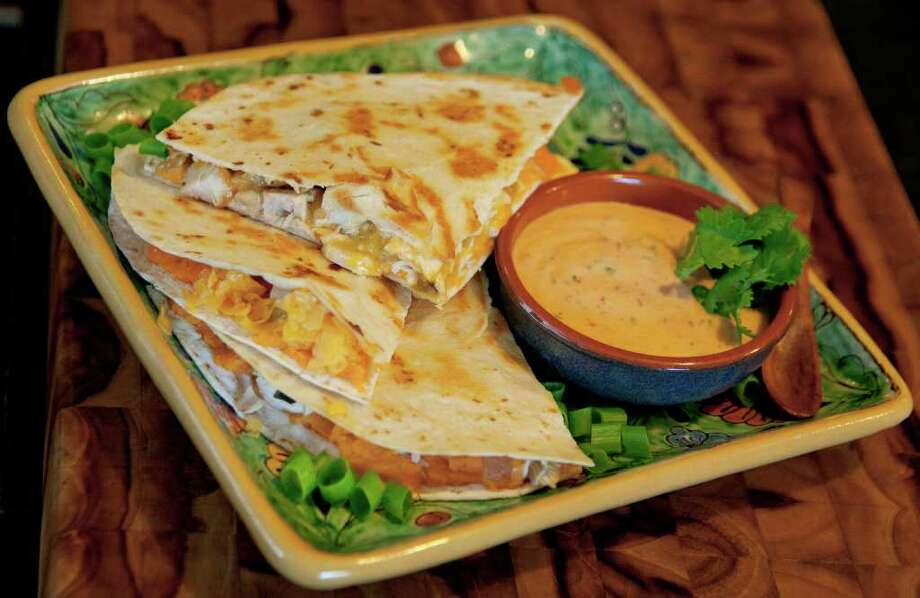 DARREN ABATE : STAFF TURKEY TEX-MEX: Think beyond the sandwich when considering what to do with leftover turkey; try Turkey And Sweet Potato Quesadillas With Chipotle Mayonnaise. Photo: Darren Abate / Special to the Express-News