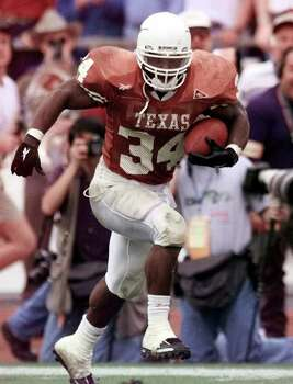 ADVANCE FOR WEEKENDS EDITION NOV. 19-20, 2011 AND THEREAFTER- FILE - In this Nov. 27, 1998, file photo, Texas running back Ricky Williams turns up field as he breaks the all-time NCAA rushing record with a 60-yard touchdown run against Texas A&M during the first quarter of an NCAA college football game in Austin, Texas. The rivalry between Texas and Texas A&M is one college football's oldest, a brother-against-brother grudge game that dates to 1894. Texas A&M is leaving the Big 12 for the SEC after one final showdown with the Longhorns on Thanksgiving night,  Thursday, Nov. 24, 2011, marking the end of a fierce intrastate series that has spawned more than its share of heroes and history. Photo: AP