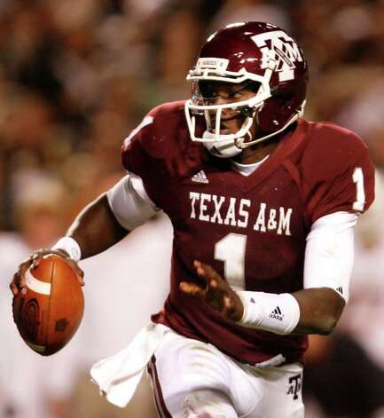 COLLEGE STATION, TX - NOVEMBER 26: Quarterback Jerrod Johnson #1 of the Texas A&M Aggies looks to throw the ball downfield to an open receiver against the Texas Longhorns in the second half at Kyle Field on November 26, 2009 in College Station, Texas. The Longhorns defeated the Aggies 49-39 (Photo by Aaron M. Sprecher/Getty Images) *** Local Caption *** Jerrod Johnson Photo: Aaron M. Sprecher, Getty Images / 2009 Getty Images