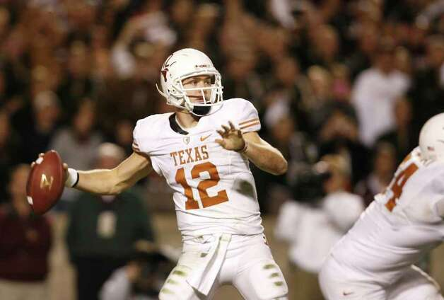 COLLEGE STATION, TX - NOVEMBER 26: Quarterback Colt McCoy #12 of the Texas Longhorns looks to pass the ball downfield against the Texas A&M Aggies in the second half at Kyle Field on November 26, 2009 in College Station, Texas. The Longhorns defeated the Aggies 49-39. Photo: Aaron M. Sprecher, Getty Images / 2009 Getty Images